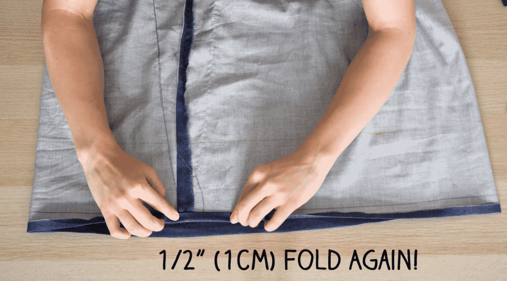 Fold Hem Again and Sew in Place - How To Sew Clothes For Beginners DIY Tank Top